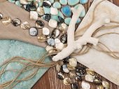stock photo of mother-of-pearl  - selection of materials for interior decoration in a nautical theme with a blue ceramic mosaic - JPG