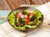 foto of veal  - bright beautiful healthy nutritious delicious sandwich made of veal sausage fried broccoli and red pepper - JPG