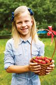 picture of strawberry blonde  - cute girl holding a basket of ripe strawberries - JPG