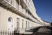 foto of row houses  - A row of terraced houses part of the Royal York Crescent in Clifton Bristol UK which is reputed to be the longest Georgian crescent in Europe
