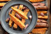 picture of potato chips  - Sweet potato roasted chips on a tin plate - JPG