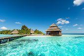 stock photo of tropical island  - small maldives tropical island with beach villas  - JPG