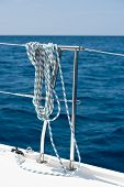 stock photo of lifeline  - A rope tied around a lifeline on a yacht - JPG