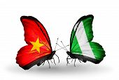 stock photo of nigeria  - Two butterflies with flags on wings as symbol of relations Vietnam and Nigeria - JPG