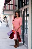 stock photo of racial diversity  - Beautiful multi ethnic diverse woman on a shopping spree - JPG