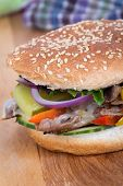 picture of cheese-steak  - philly cheese steak burger sandwich with vegetables - JPG