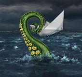 stock photo of trap  - Business trouble and financial trap concept as an origami paper boat in a stormy sea being trapped by a monster tentacle squeezing the victim as a metaphor for career and entrpreneur risk - JPG