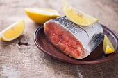 stock photo of redfish  - Fresh raw salmon on wooden background - JPG