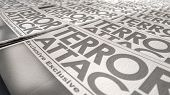 stock photo of terrorism  - A long row of folded newspapers at the end of a press run with a generic headline that reads terror attack on the front page on an isolated white background - JPG