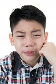 stock photo of crying boy  - asian cute boy sad and crying on white background - JPG
