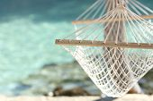 stock photo of rest-in-peace  - Travel concept with a hammock in a tropical beach with turquoise water in the background - JPG