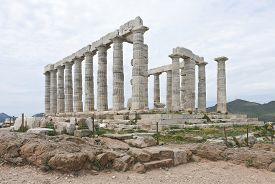 stock photo of poseidon  - Ruins of the Poseidon temple at the very tip of cape Sounio - JPG