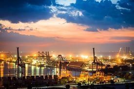 picture of shipyard  - Industrial Container Cargo freight ship with working crane bridge in shipyard at sunset  - JPG