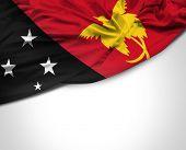 stock photo of guinea  - Papua New Guinea waving flag on white background - JPG