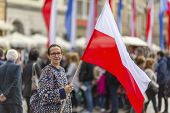 pic of polonia  - Woman on the street holding a flag of the Republic of Poland - JPG