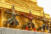 picture of guardian  - Mythological demon guardian outside Buddhist temple at the Grand Palace in Bangkok Thailand - JPG