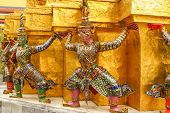 stock photo of guardian  - Mythological demon guardian outside Buddhist temple at the Grand Palace in Bangkok Thailand - JPG