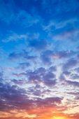 stock photo of cloudy  - Beautiful cloudy sunset - JPG