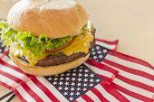 foto of patriot  - Patriotic American flag cheeseburger for American patriotism celebration food image - JPG