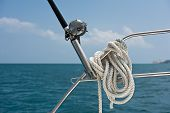 foto of rod  - Fishing rod and reel on a sailing yacht - JPG