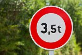 stock photo of restriction  - Traffic sign of 35 tons weigh restriction on a rural road background - JPG