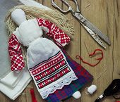 picture of rag-doll  - Belarusian traditional doll  production on a wooden background - JPG