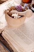 image of roughage  - Old book with dry flowers in mortar close up - JPG
