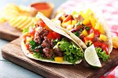 stock photo of potato chips  - Homemade beef burritos with vegetables - JPG