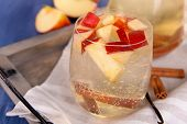 picture of cider apples  - Glass and carafe of apple cider with fruits and spices on table close up - JPG