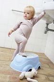 picture of bathroom sink  - Girl Standing On Step In bathroom To Reach Sink - JPG