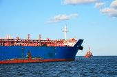 stock photo of towing  - Tug boat towing a tanker ship at sea - JPG