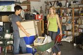 picture of yard sale  - Two Teenagers Clearing Garage For Yard Sale - JPG