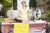 foto of yard sale  - Teenage Girl Holding Yard Sale - JPG