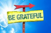 stock photo of humility  - Be Grateful sign with sky background - JPG