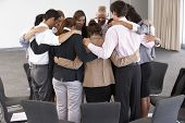 picture of bonding  - Group Of Businesspeople Bonding In Circle At Company Seminar - JPG