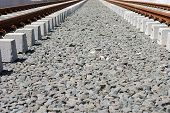 picture of tram  - The road bed of a newly laid rail track for a tram with rails and gravel underlay - JPG