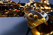 pic of saxophones  - saxophone and martini with green olives focus onberry  - JPG