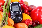 foto of immune  - Glucose meter with fresh ripe fruits and vegetables concept of diabetes healthy food nutrition and strengthening immunity - JPG