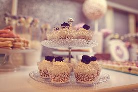 stock photo of sugarpaste  - Capture of several delicious Cupcakes on plate - JPG
