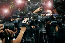 picture of communication  - press and media camera video photographer on duty in public news coverage event for reporter and mass media communication - JPG
