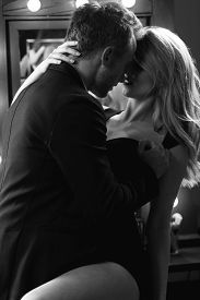 picture of touching  - Romantic couple embracing touching and kissing with passion - JPG