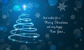 Shiny Christmas Tree And Snowflakes On Blue Winter Background. Merry Christmas And Happy New Year Wa poster