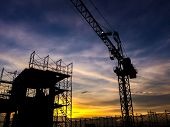 Постер, плакат: Silhouette Of Scaffolding In The Construction Site Before To Night Time Or Sunset Time Worker Empty