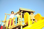 picture of subdivision  - Playing in park together - JPG