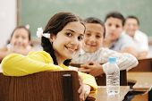 pic of pre-teen boy  - Happy cute children in classroom with their teacher - JPG