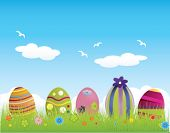 foto of easter-eggs  - Easter eggs in a grassland - JPG
