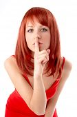 pic of taboo  - young woman gesturing silence - JPG