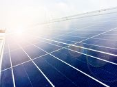 Soft Focus Of Solar Panels Or Solar Cells On Factory Rooftop Or Terrace With Sun Light, Industry In poster