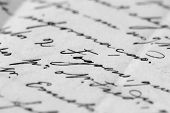 a background detail of an ancient letter (selective and soft focus)