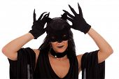 black cat woman showing her claws (isolated on white)